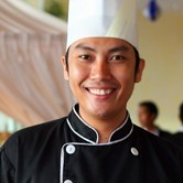 Young man in chefs clothing